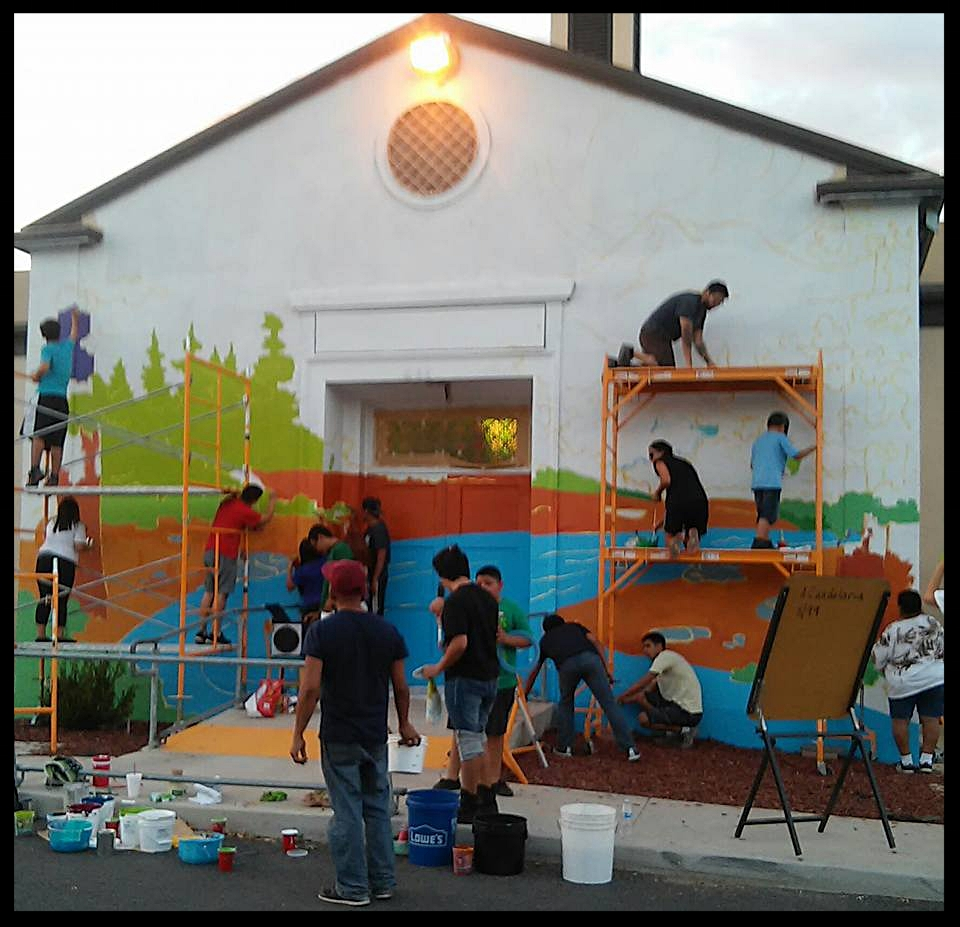 Victor Cervantes facilitates a mural project on the local community center in Porterville, CA: Comisión Honorífica Mexicana Americana (CHMA)