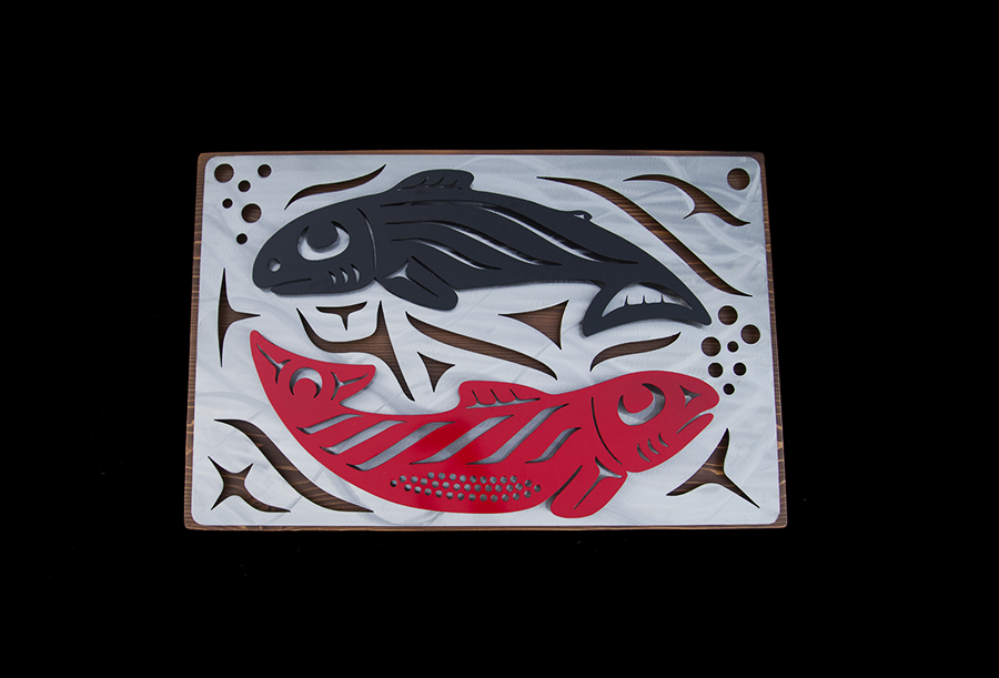 """Salmon in Unity"" designed by First nation artist Trevor Husband shown her with cedar back. Finished in clear plaque, with red/black salmon."
