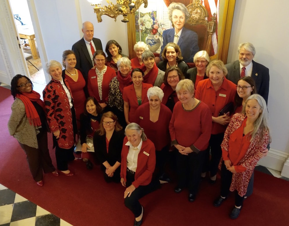 MOLLIE (KNEELING, FOURTH FROM LEFT) WITH LEGISLATIVE COLLEAGUES CELEBRATING THE EQUAL PAY DAY RESOLUTION IN APRIL 2016 PHOTO COURTESY OF MOLLIE BURKE