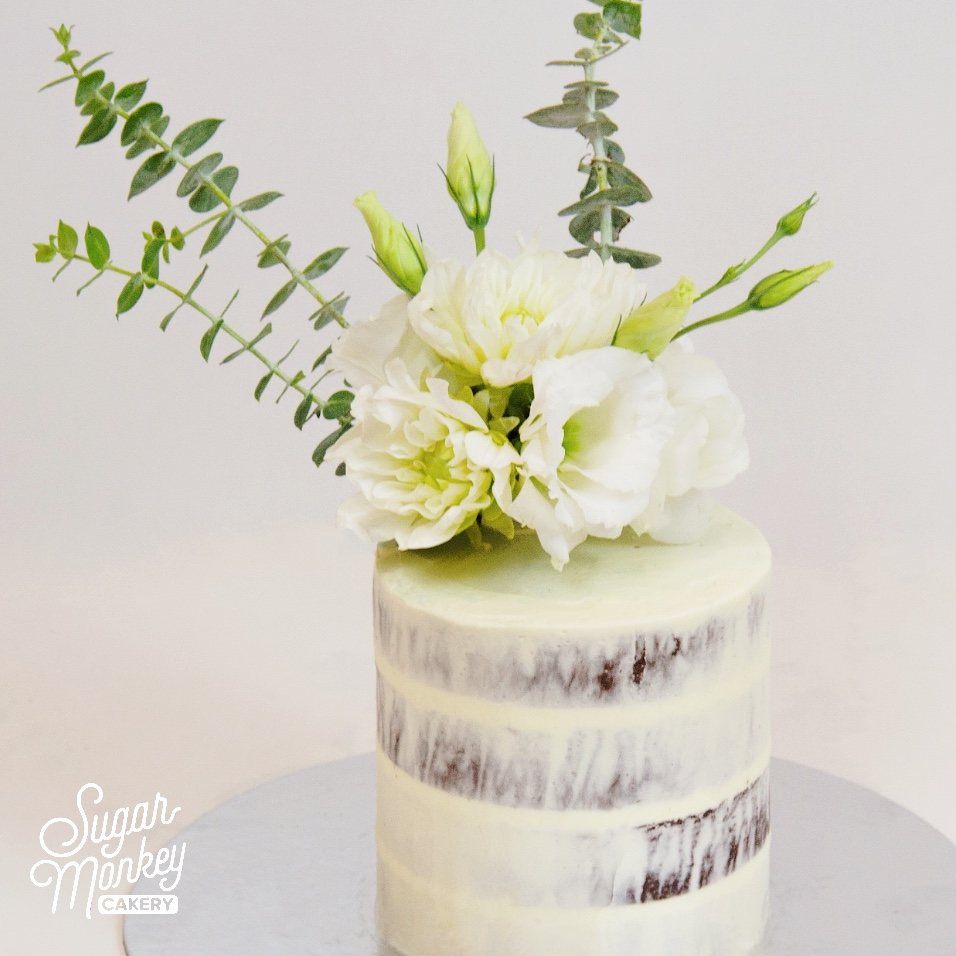 White and green themed baby shower cake