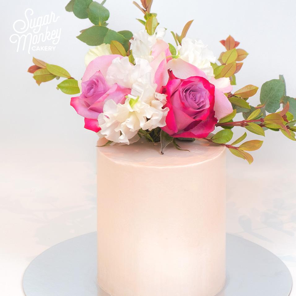 Birthday cake with flower arrangement