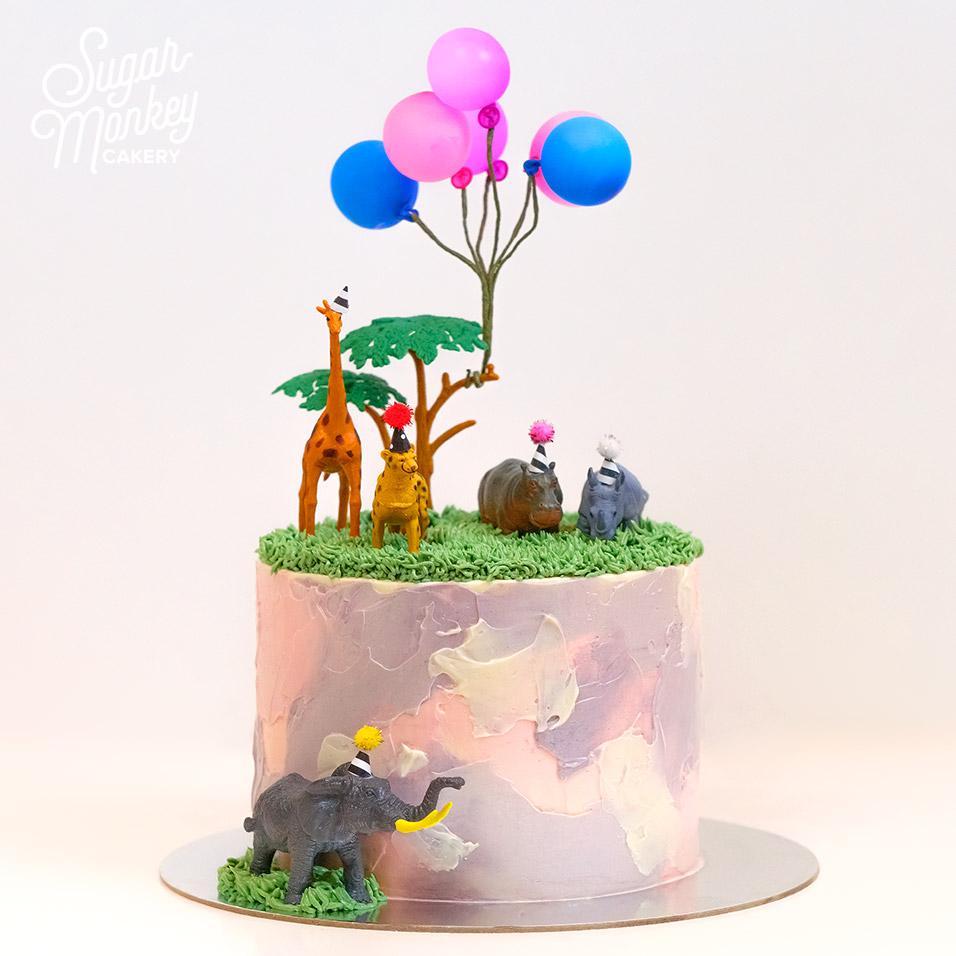Animal party birthday cake