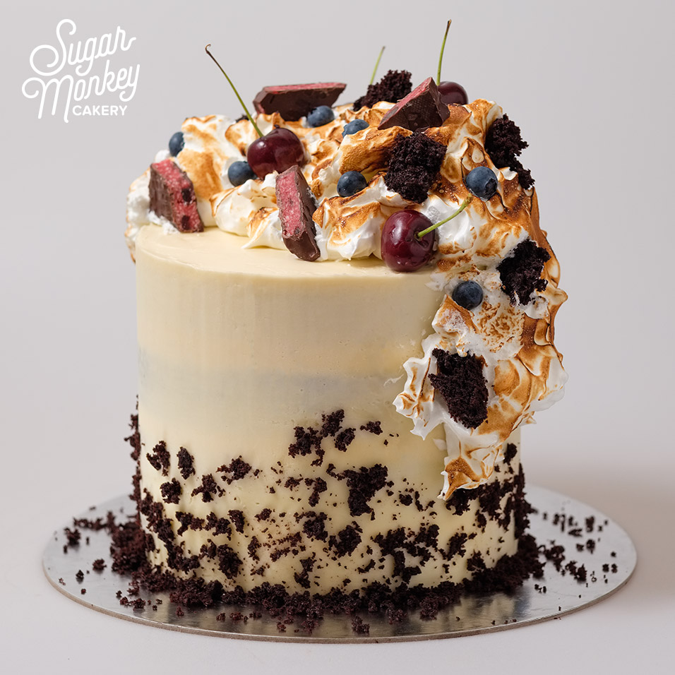 Black Forest cake topped with torched meringue