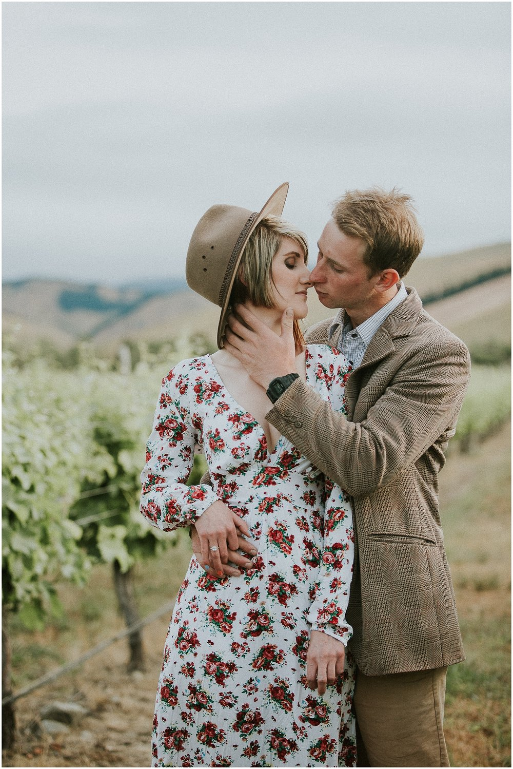 Young Couple In Vineyard Embracing