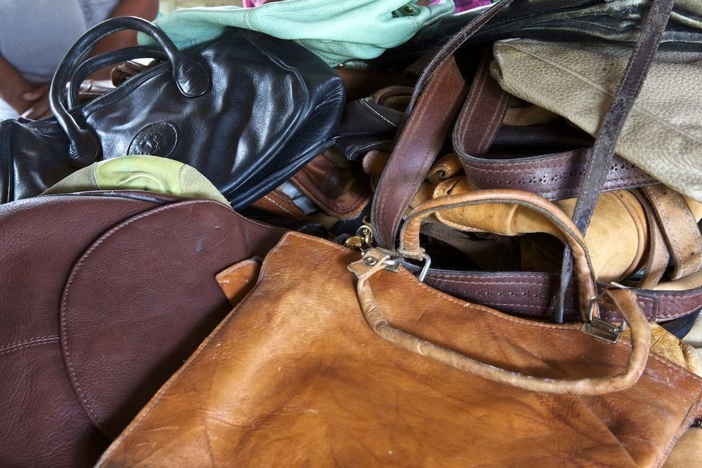 Lumago reuses old leather from bags and jackets, it has to be real otherwise it just crumbles when cut! We purchase the leather from second hand stores across the city or sometimes we are lucky enough to receive donations.