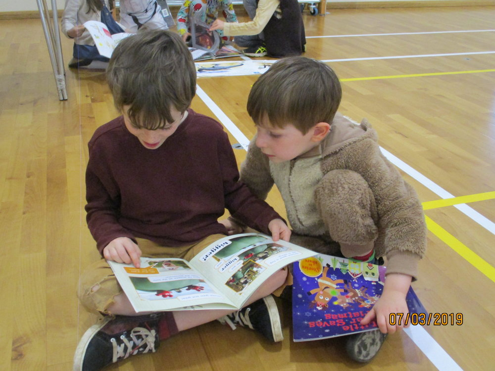 Every day we are 'Reading Buddies' to our friends in Reception and Pre-School-we especially loved reading to each other when we were dressed as our favourite book characters!