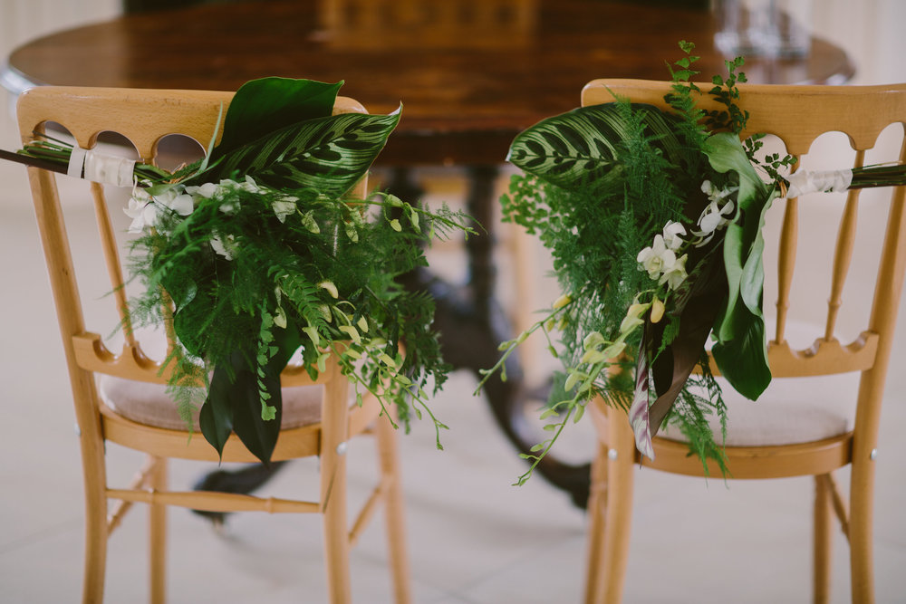 tropical chair backs wedding white and green