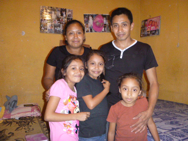 Fernanda with her family at home