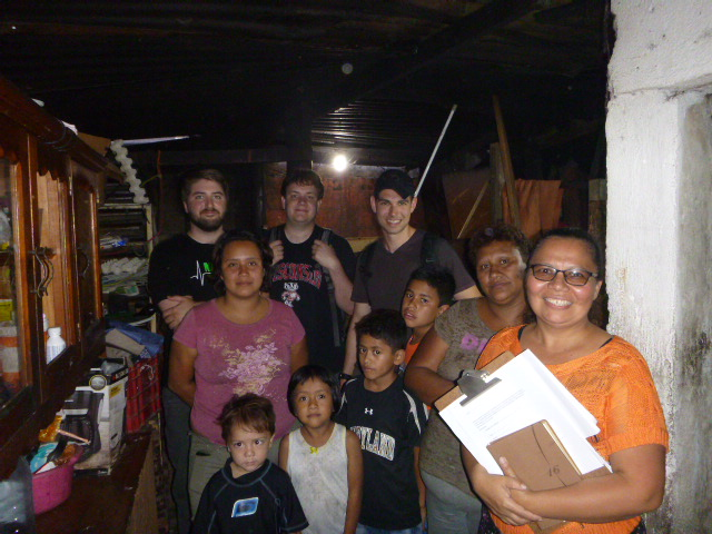 Christian, his family, and volunteers at his home