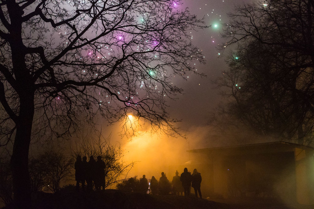Watching the fireworks in the fog - Photo by Unn Elise Refsnes - [35mm f1.4 1/50 iso1600]