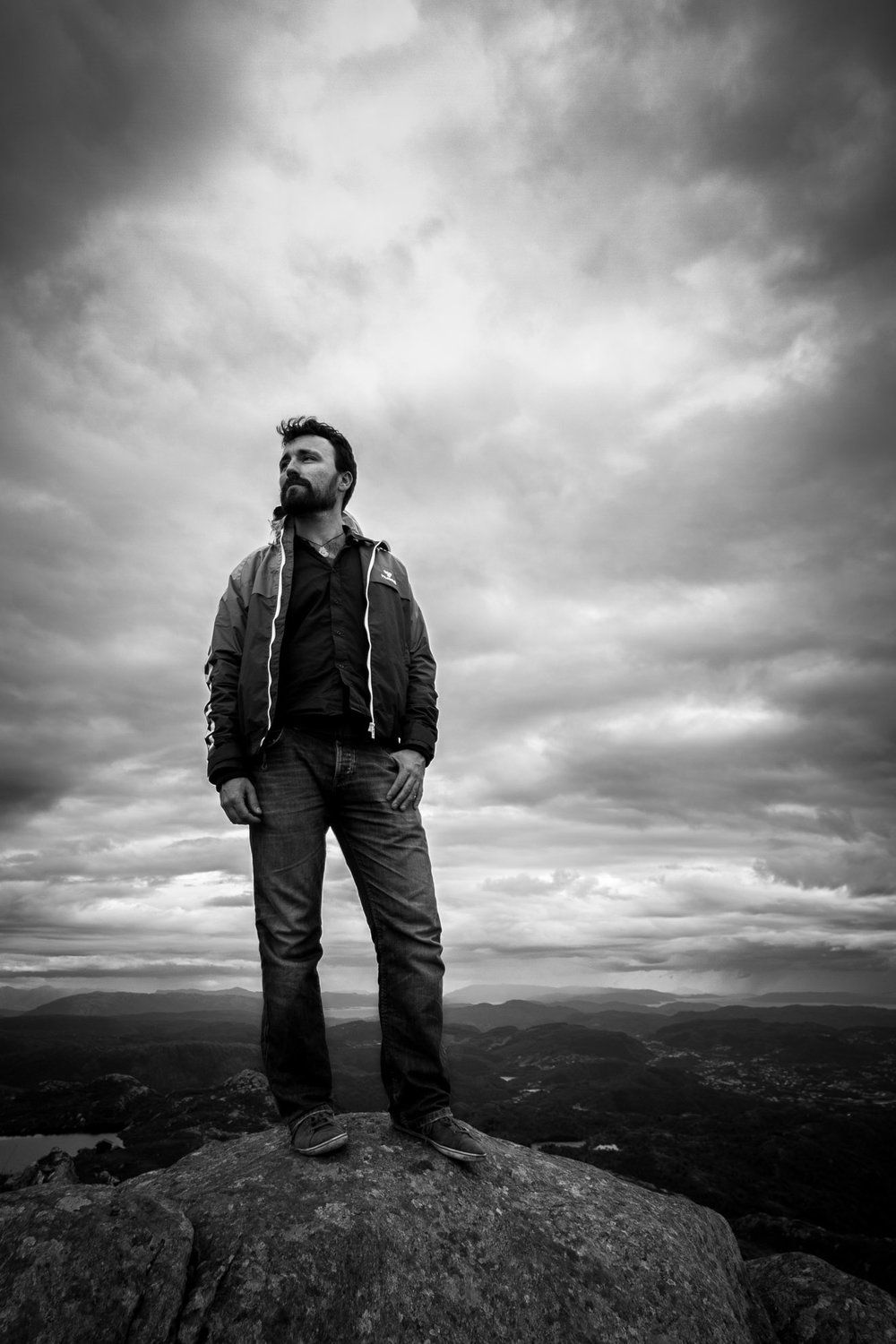 Dramatic black and white mountain top portrait