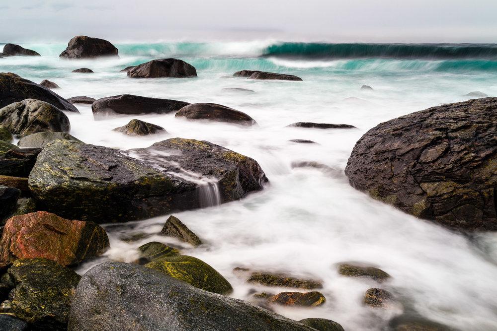 Crashing waves on rocky beach