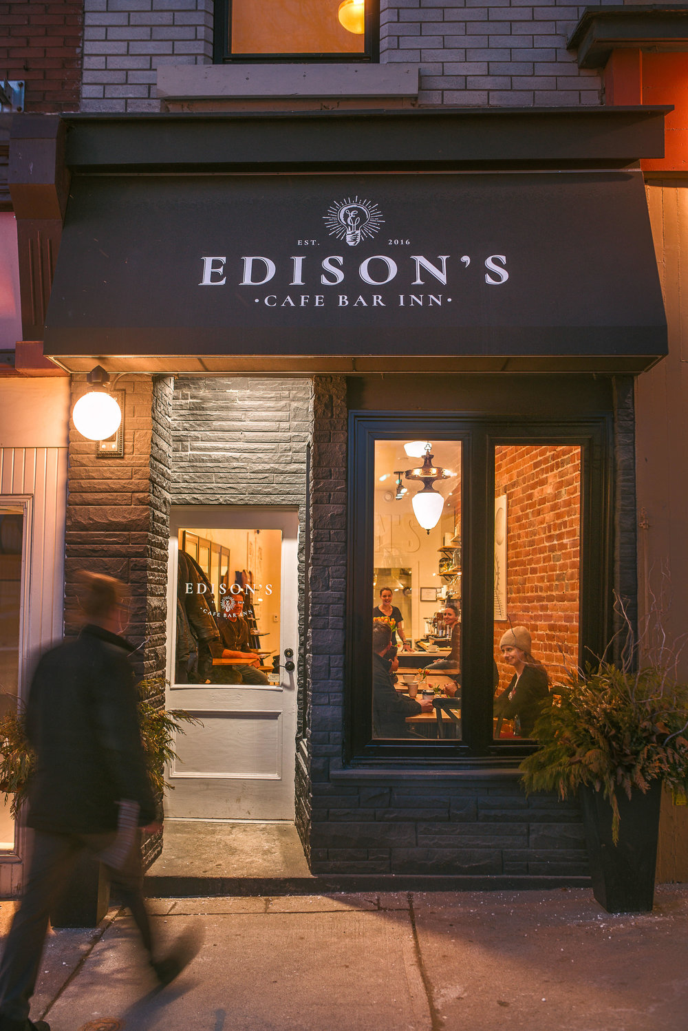 WE'D LOVE YOU TO BE OUR GUEST   EDISON'S Cafe Bar and Inn, in the heart of downtown Stratford, Ontario, is a space designed to give you a small, deserved break from the daily grind. We want to inspire you by our ideas, design, music, snacks, beverages and friendship. When you leave, our hope is that you are refreshed and energized to take on whatever lies ahead with passion, strength and humour.