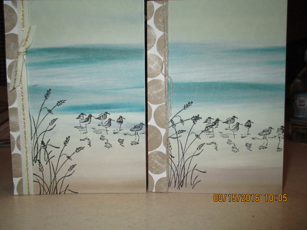 "These cards were produced using the Serene Scenery Cardstock Pack (48 sheets of Designer Series Paper 6x6 - Item #141642), Wetlands Stamp Set (Item # 126697 photopolymer), Basic Black Archival Ink Pad (Item #140931)  Also used the 1/4"" Gold Natural Trim (Item #141484) and Linen Thread (Item # 104199) and of course I used the Whisper White Note Cards w/ Envelopes (Item # 131527) These cards turned out so cute.....and really there isn't much to them."