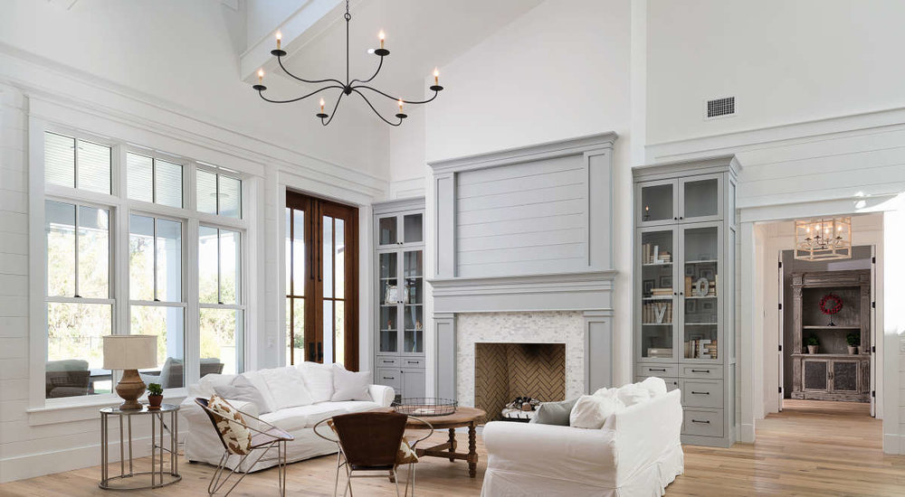 Shiplap design halfway up the wall in a tall ceiling home.