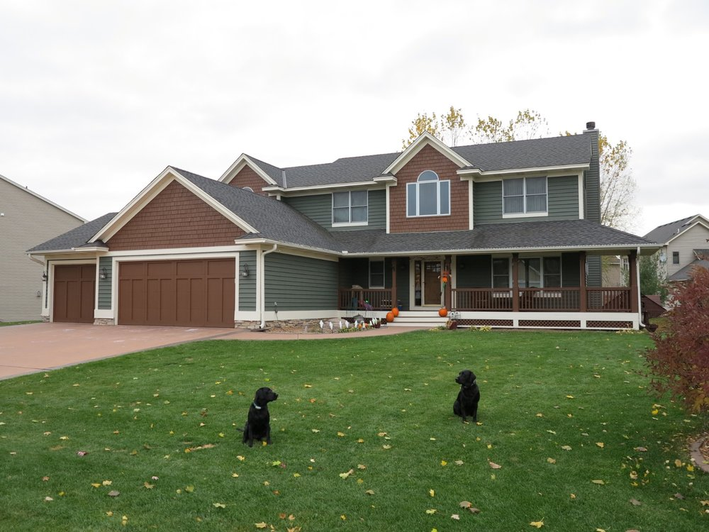 A beautiful home in darker primary colors that speak to the homeowner's style. The two hunting dogs may give it away...