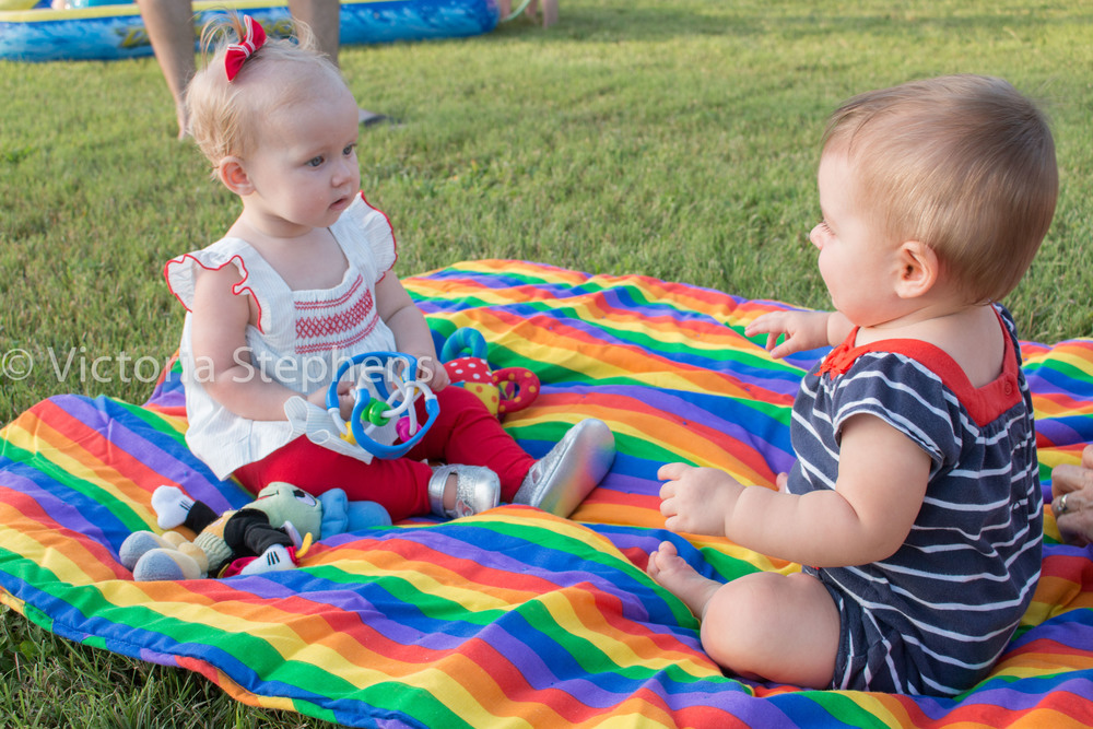 Baby R with Bellamy last 4th of July, enjoying a backyard party, playing on a blanket! Can't believe both these babies are almost two!
