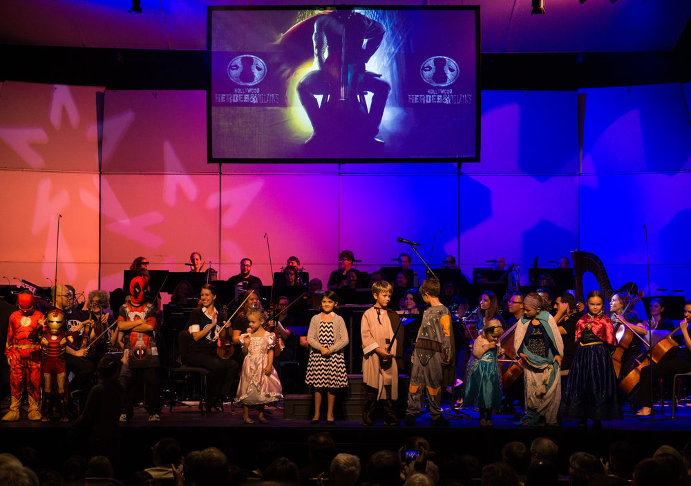 Children on stage with the Lancaster Symphony Orchestra in their best superhero attire.