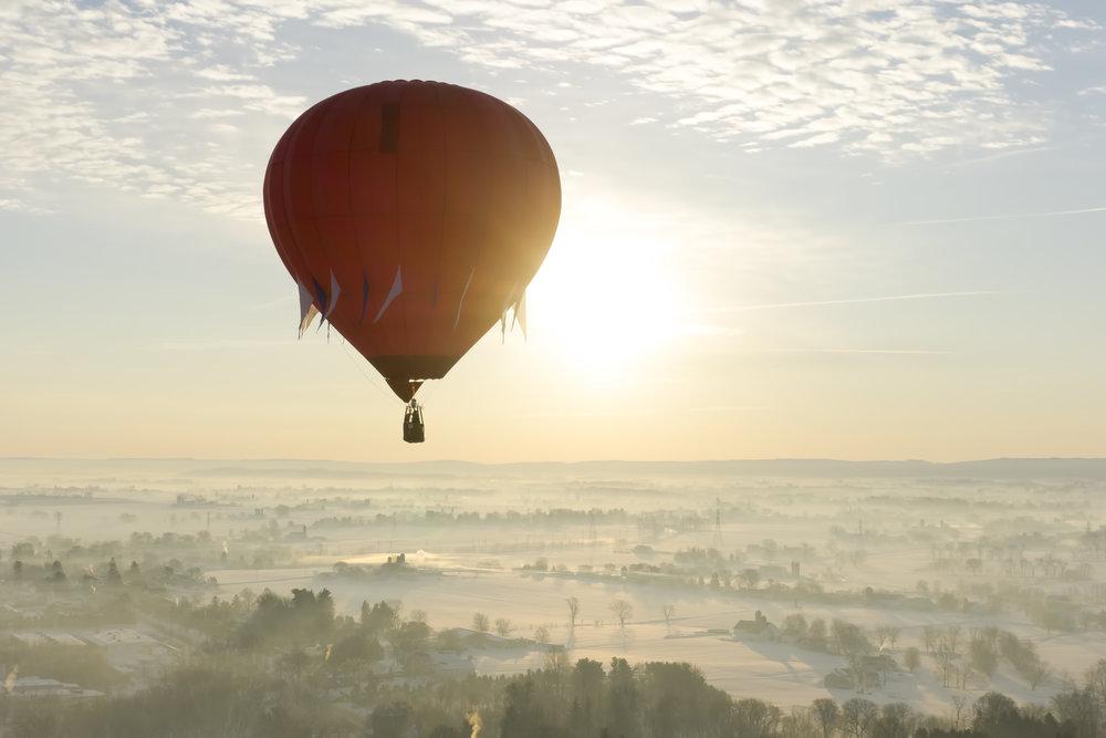 hot air balloon tour - red balloon crossing sunrise(p).jpg