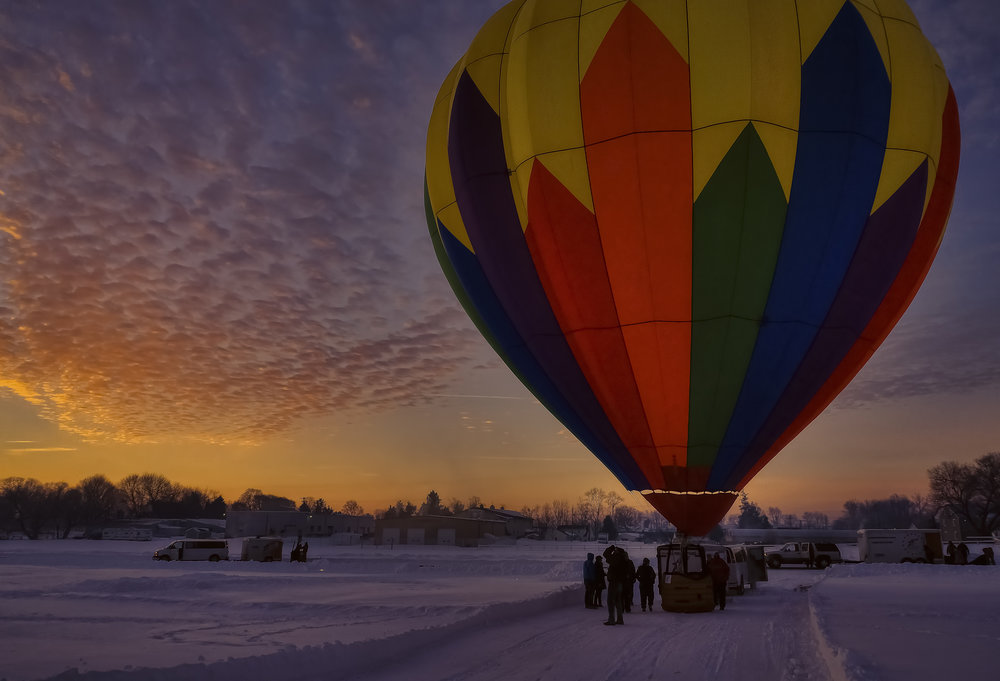 Inflating the balloons before sunrise at the Smoketown Airport.