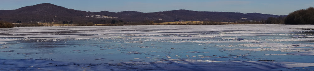 Panorama of the frozen lake at Middlecreek Wildlife Management Area