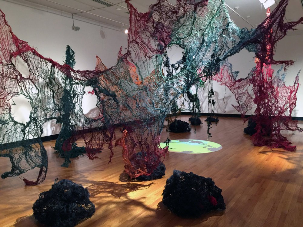 Nnenna Okore,  Nkata,  2015, burlap, cheesecloth, paper, jute rope, glass, wire, dye and video; Krannert Museum of Art.