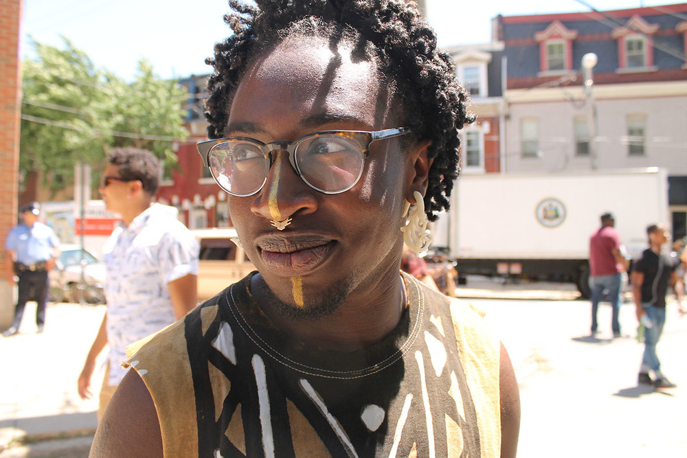 """There's so much love, good music and so many black people.""  says Kavindu Ade, 25, at the Odunde Festival on South Street in Philadelphia, Pa. on Sunday June 12, 2016. Photography by Sofiya Ballin."