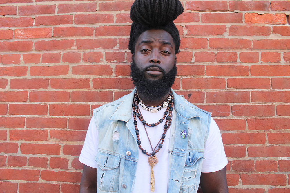 esse Piggott, 23, killing the locs pompadour game at the Odunde Festival on South Street in Philadelphia, Pa. on Sunday June 12, 2016. Photography by Sofiya Ballin.