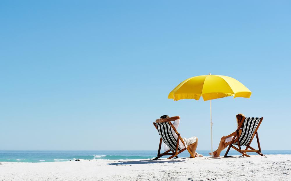 Beach-umbrella-in-sand-at-beach
