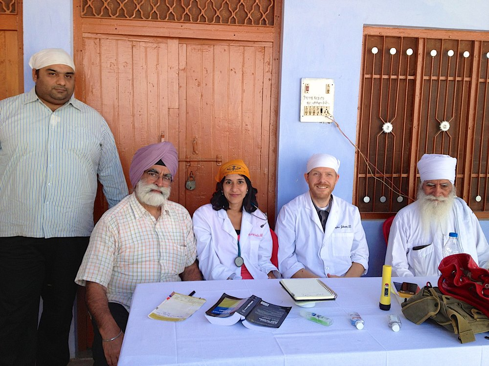 Doctors: Dr. Kernjeet K. Sandhu and Dr. Christopher L. Johnston with Baba Jagtar Singh Ji at Marhana medical camp.