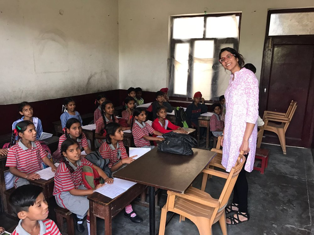 Dr. Sandhu with the local children in their classroom setting. These children are taught by volunteer teachers and there is no cost for them to attend school. All supplies and uniforms are donated.