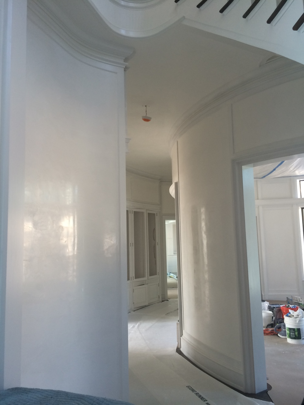 A work in progress. This angle shows the polished look of this beautiful white Venetian plaster