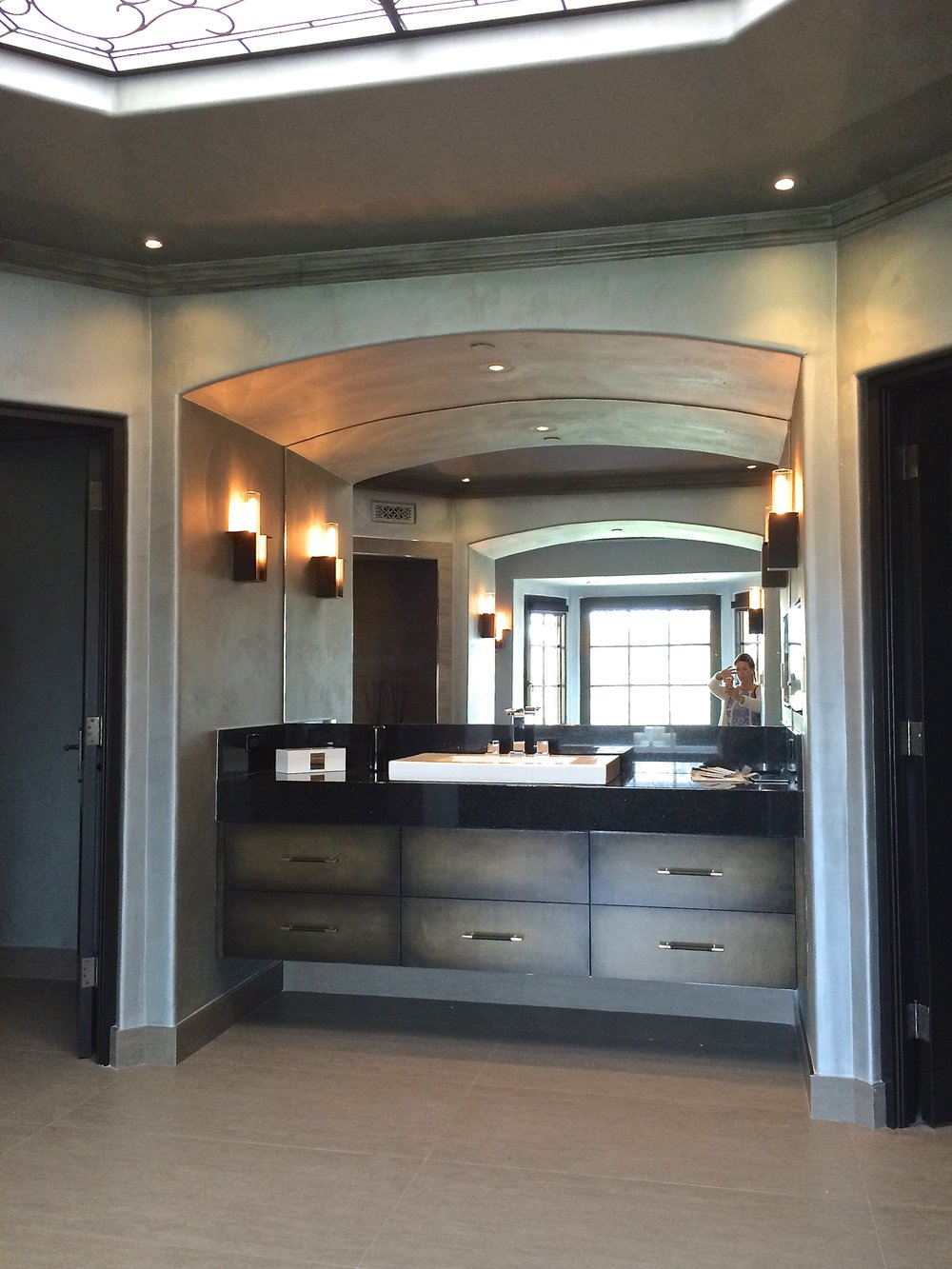 Faux suede plaster walls and custom paint finish on the cabinets.