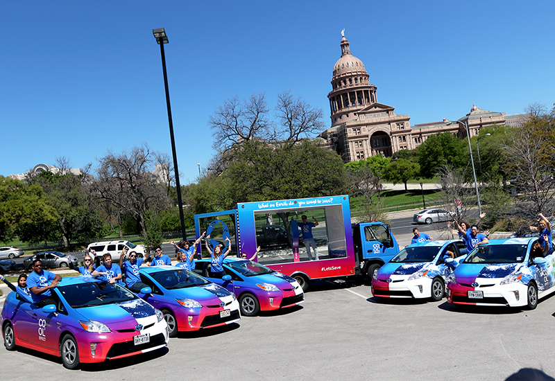 Cool Effect brand ambassadors show off branded vehicles outside Austin's State Capitol building.