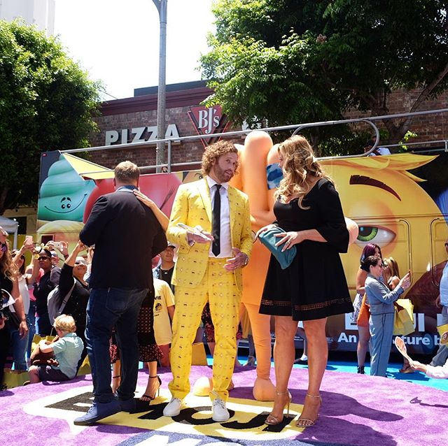 "Only @teenagemillionaire could pull off bold colors like that on a ""red"" carpet... oh and our double deckers can too. #EmojiMovie #Premiere"