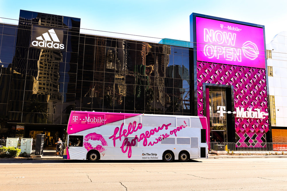 A Deuce Double Decker passes by the new T-Mobile signature-style store on the Las Vegas Strip, just around the corner from T-Mobile Arena. Las Vegas was the first market in Vector Media's roster to offer public transit advertising solutions, and is now one of over 25 such markets.