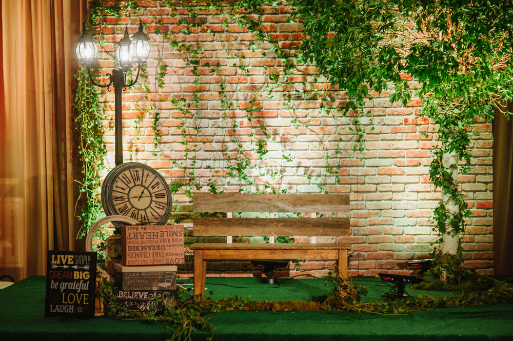 BENCH WITH BRICK BACKDROP