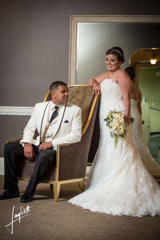 BRIDE AND SITTING GROOM