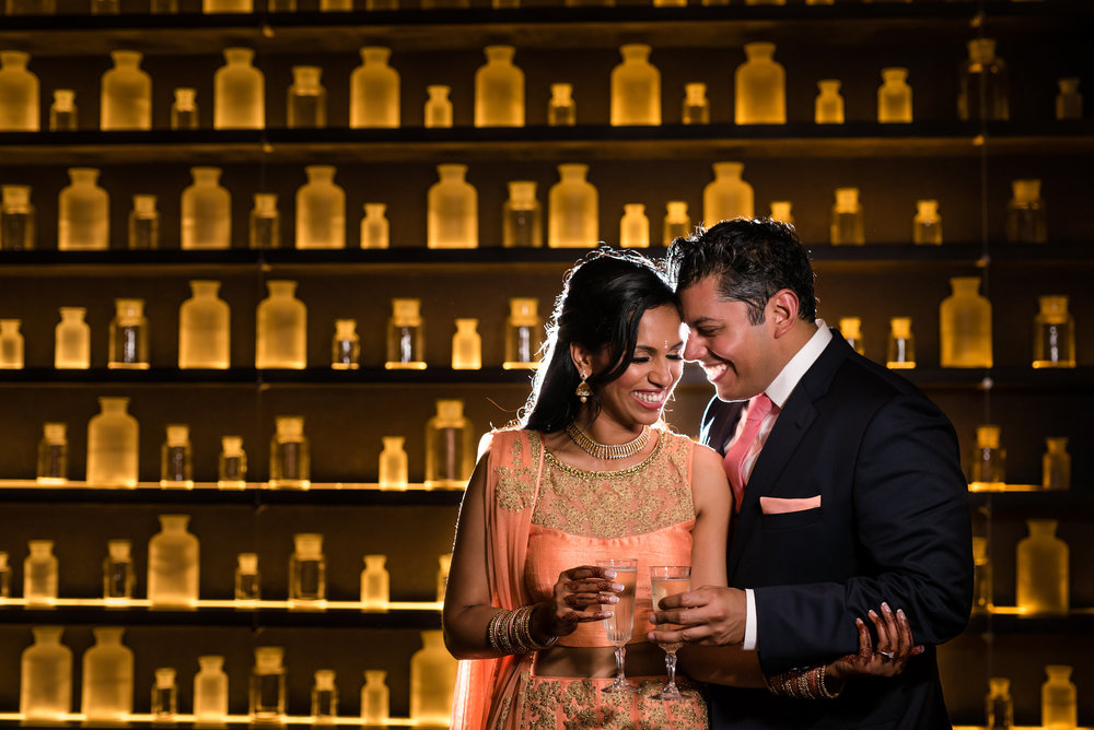 COUPLE IN FRONT OF GLASS WALL