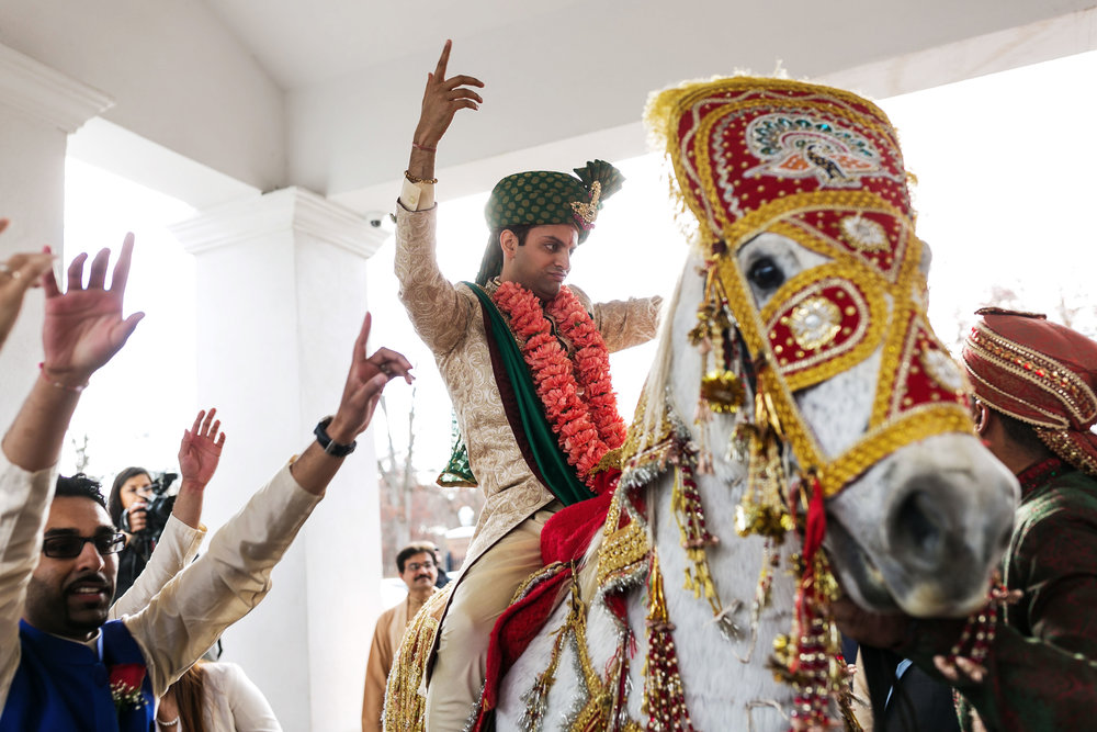 INDIAN GROOM AT WEDDING BARAAT WITH HORSE.JPG