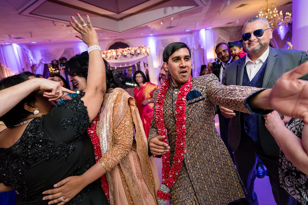 INDIAN WEDDING BRIDE AND GROOM DANCING WITH FAMILY.jpg