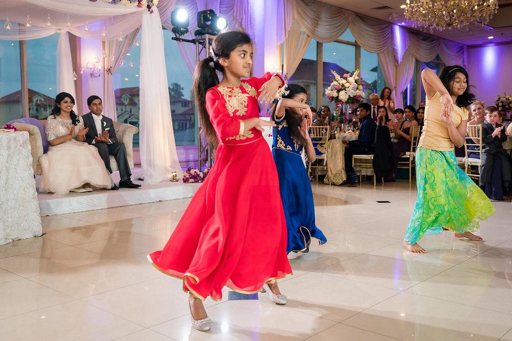 INDIAN WEDDING BRIDE AND GROOM WATCH DANCING SHOW.jpg
