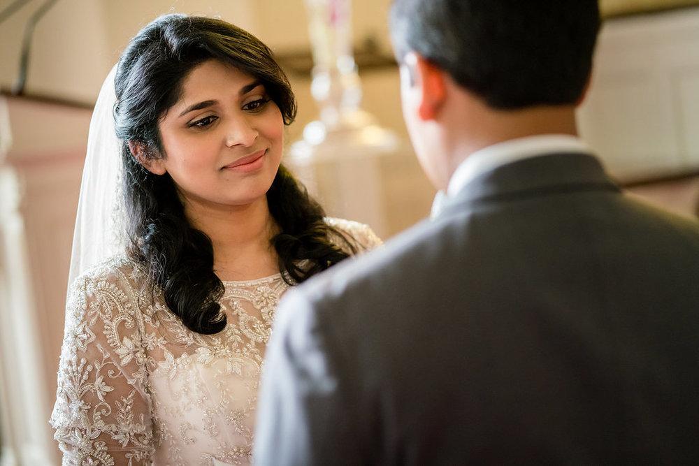 INDIAN WEDDING BRIDE LOOKING AT GROOM.jpg