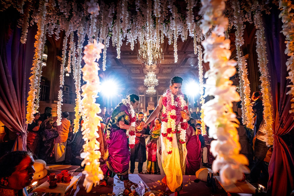 INDIAN WEDDING BRIDE AND GROOM ENTERING FLOWER ALTER.JPG