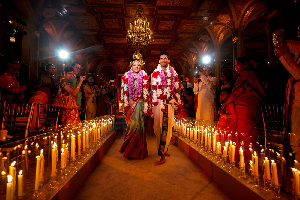 INDIAN WEDDING BRIDE AND GROOM WALKING DOWN CEREMONY AISLE.JPG