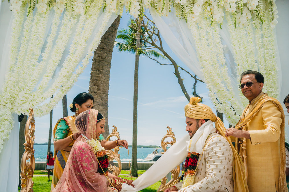 INDIAN WEDDING BRIDE AND GROOM ON ALTER2.JPG
