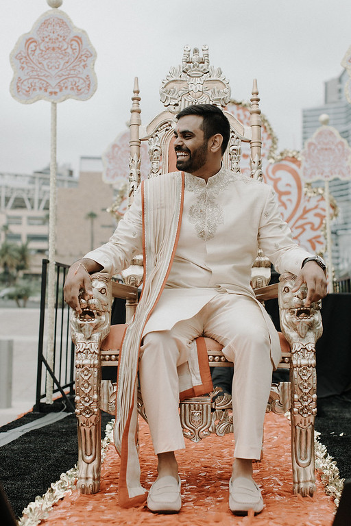INDIAN WEDDING GROOM ON CHAIR.jpg