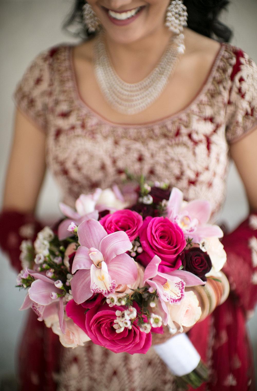 INDIAN WEDDING BRIDE WITH FLOWER BOUQUET.jpg