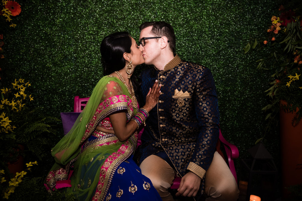 INDIAN WEDDING SANGEET BRIDE AND GROOM KISS.jpg