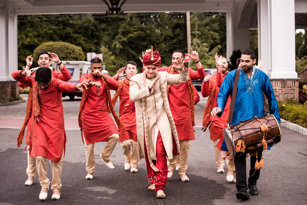 INDIAN WEDDING GROOM DANCING INTO CEREMONY.jpg
